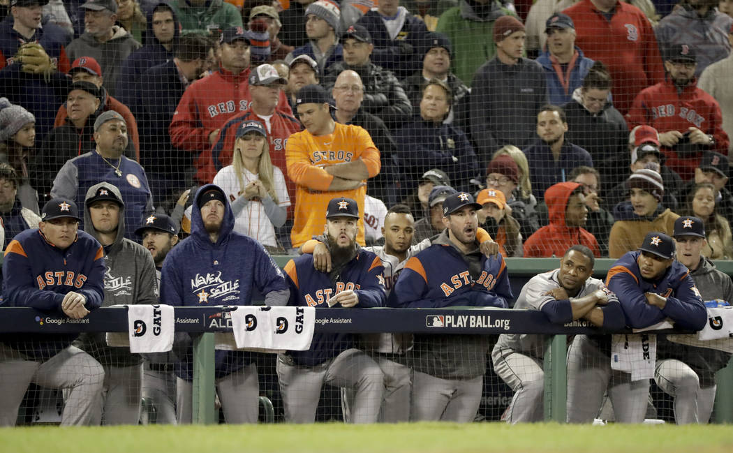 Members of the Houston Astros watch during the ninth inning in Game 2 of a baseball American League Championship Series against the Boston Red Sox on Sunday, Oct. 14, 2018, in Boston. (AP Photo/Da ...