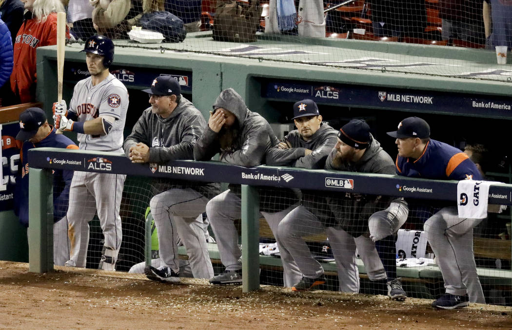 Members of the Houston Astros watch during the ninth inning in Game 2 of a baseball American League Championship Series against the Boston Red Sox on Sunday, Oct. 14, 2018, in Boston. The Red Sox ...