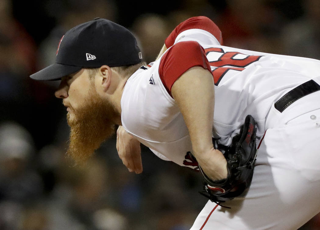 Boston Red Sox relief pitcher Craig Kimbrel looks to throw during the ninth inning in Game 2 of a baseball American League Championship Series against the Houston Astros on Sunday, Oct. 14, 2018, ...
