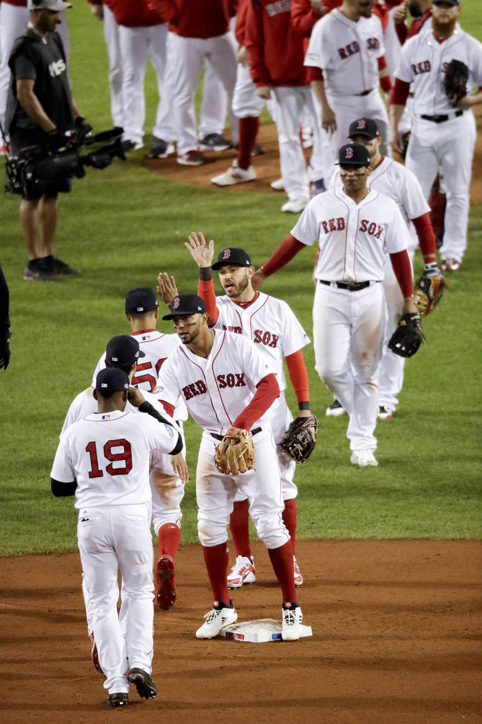 Members of the Boston Red Sox celebrate after their 7-5 win against the Houston Astros in Game 2 of a baseball American League Championship Series on Sunday, Oct. 14, 2018, in Boston. (AP Photo/El ...