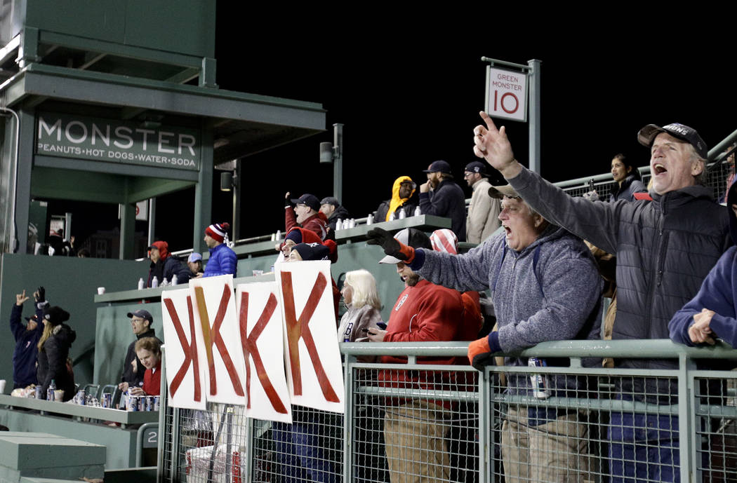 Boston Red Sox fans celebrate during the eighth inning in Game 2 of a baseball American League Championship Series against the Houston Astros on Sunday, Oct. 14, 2018, in Boston. (AP Photo/Elise A ...