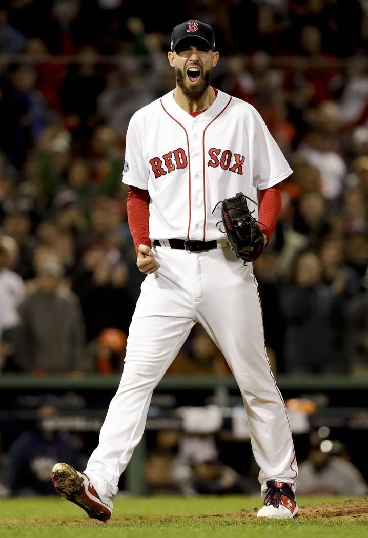 Boston Red Sox pitcher Rick Porcello celebrates after the last out in the top of the eighth inning in Game 2 of a baseball American League Championship Series against the Houston Astros on Sunday, ...
