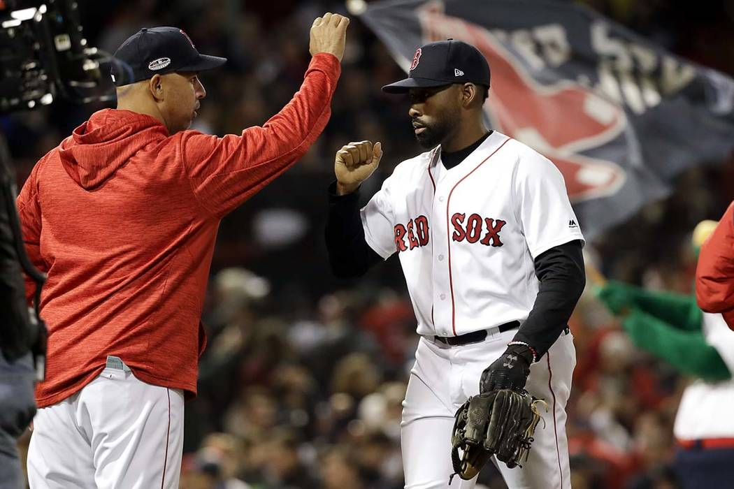 Boston Red Sox manager Alex Cora, left, and center fielder Jackie Bradley Jr. celebrate after their win against the Houston Astros in Game 2 of a baseball American League Championship Series on Su ...