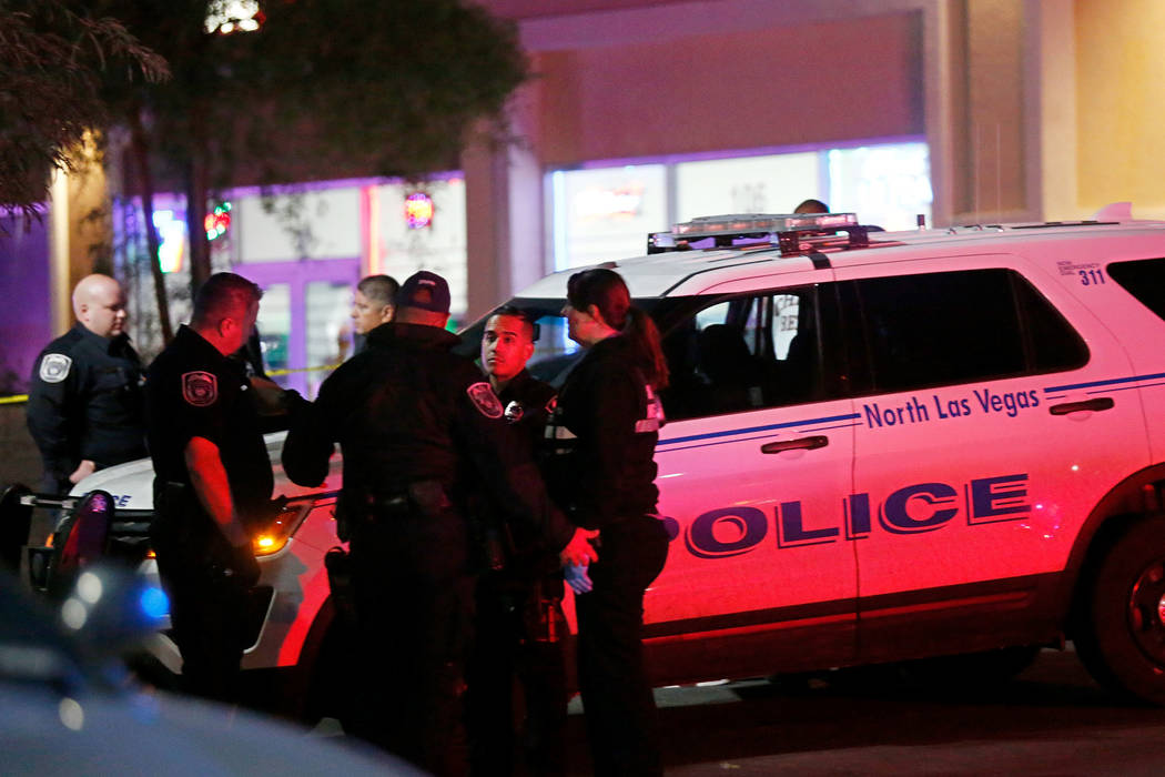 North Las Vegas police investigate a homicide Sunday night, Oct. 14, 2018, near West Lake Mead Boulevard and Simmons Street. Chitose Suzuki Las Vegas Review-Journal @chitosephoto