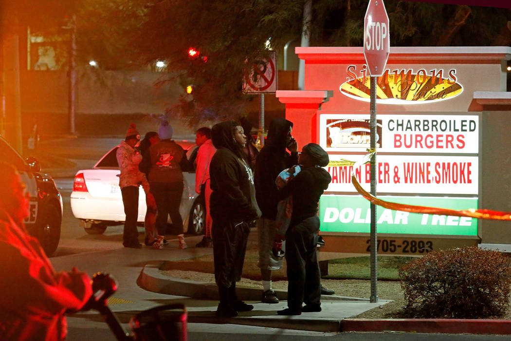 People watch North Las Vegas police investigating a homicide Sunday night, Oct. 14, 2018, near West Lake Mead Boulevard and Simmons Street. Chitose Suzuki Las Vegas Review-Journal @chitosephoto