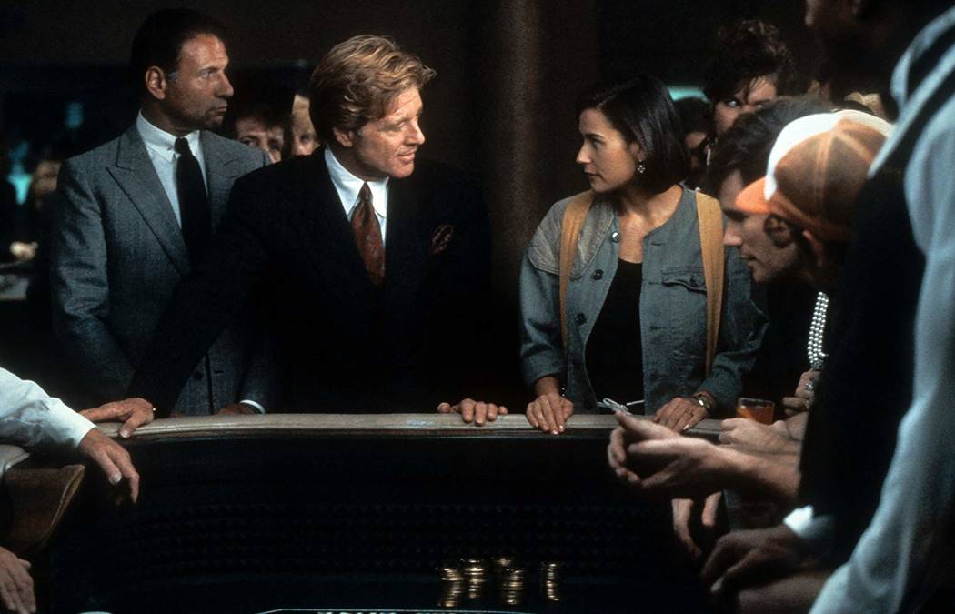 """Robert Redford and Demi Moore hit the craps table at the Las Vegas Hilton during a scene from """"Indecent Proposal."""" Photo by Paramount Pictures"""