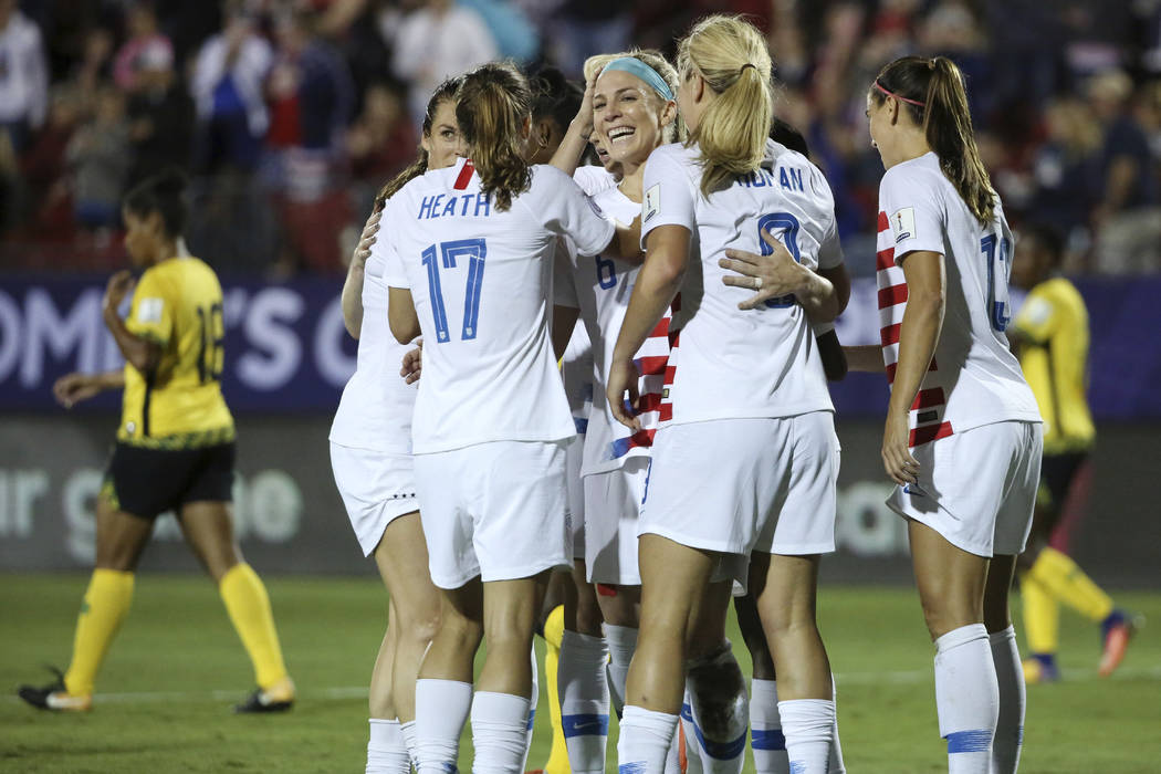 Teammates celebrate after United States midfielder Julie Ertz (facing camera) scored a goal during the first half of a CONCACAF women's World Cup qualifying tournament soccer match in Frisco, Texa ...