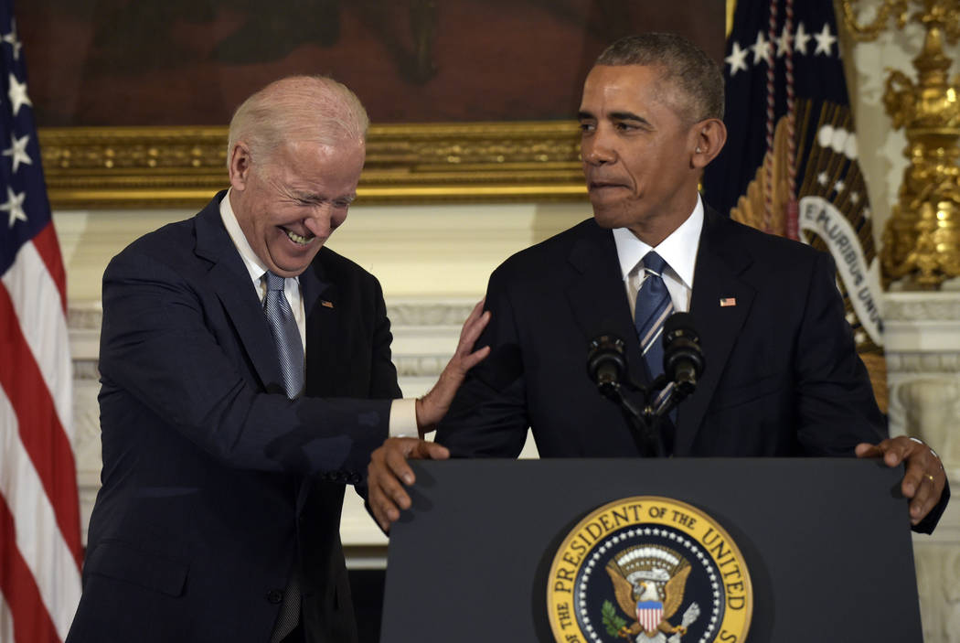 Vice President Joe Biden laughs as President Barack Obama talks about him during a ceremony at the White House in Washington, Thursday, Jan. 12, 2017. Obama surprised Biden and presented him with ...