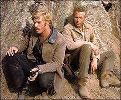 """Robert Redford, left, is Sundance and Paul Newman is Butch, debating whether to jump off a cliff into a river in """"Butch Cassidy and the Sundance Kid."""""""