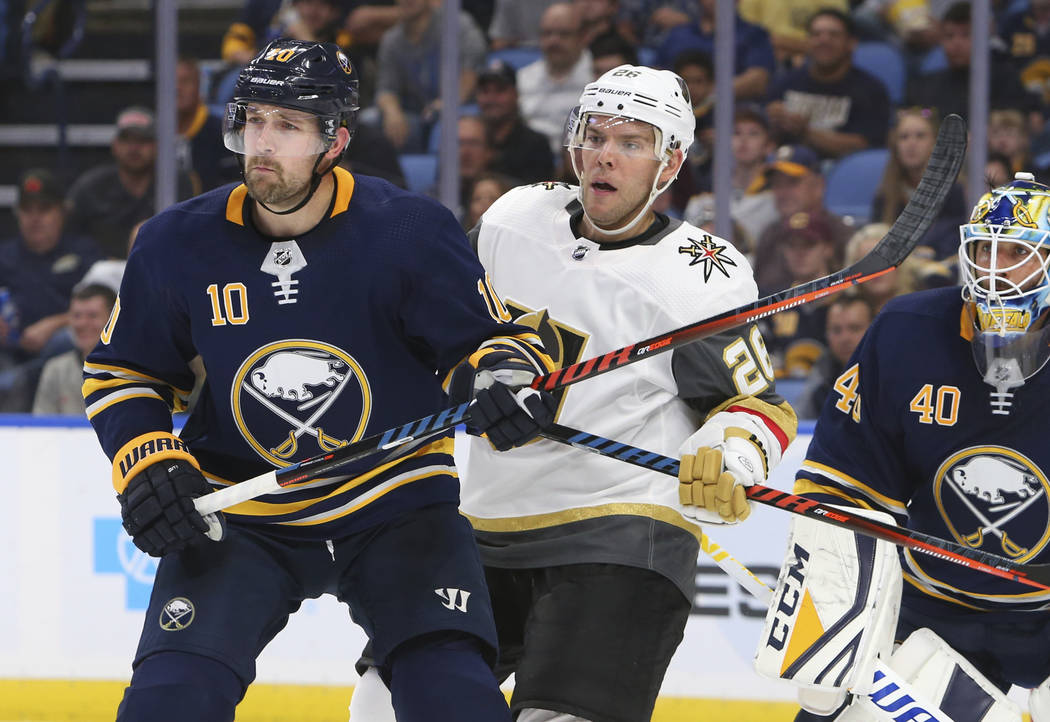 Buffalo Sabres forward Patrik Berglund (10) and Vegas Golden Knights forward Paul Stastny (26) battle in front of net during the second period of an NHL hockey game, Monday, Oct. 8, 2018, in Buffa ...