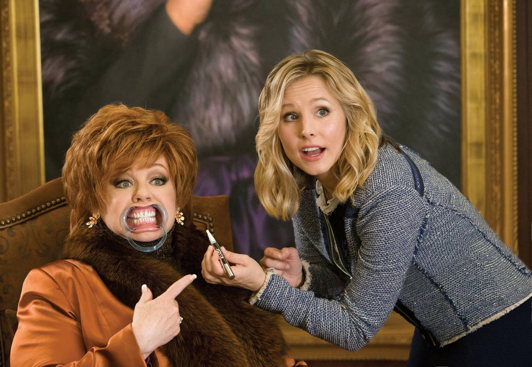 "(L to R) Michelle Darnell (MELISSA MCCARTHY) gets a little cosmetic help from Claire (KRISTEN BELL) in ""The Boss."" McCarthy headlines the comedy as a titan of industry who is sent to pr ..."