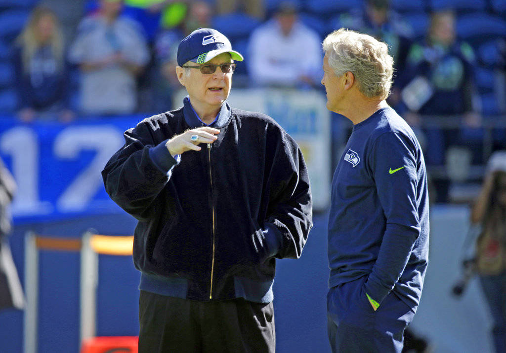 Seattle Seahawks owner Paul Allen, left, talks with Seahawks head coach Pete Carroll before an NFL football game against the Chicago Bears in Seattle, Sept. 27, 2015. Allen, billionaire owner of t ...
