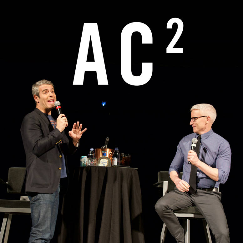 Andy Cohen, left, and Anderson Cooper on stage