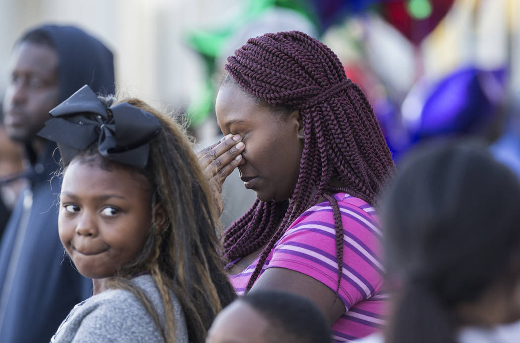Friends and family come together during a vigil to mourn the loss of the 3 people killed Sunday night during a shooting at West Lake Mead Boulevard and Simmons Street. Photo taken at the site of t ...