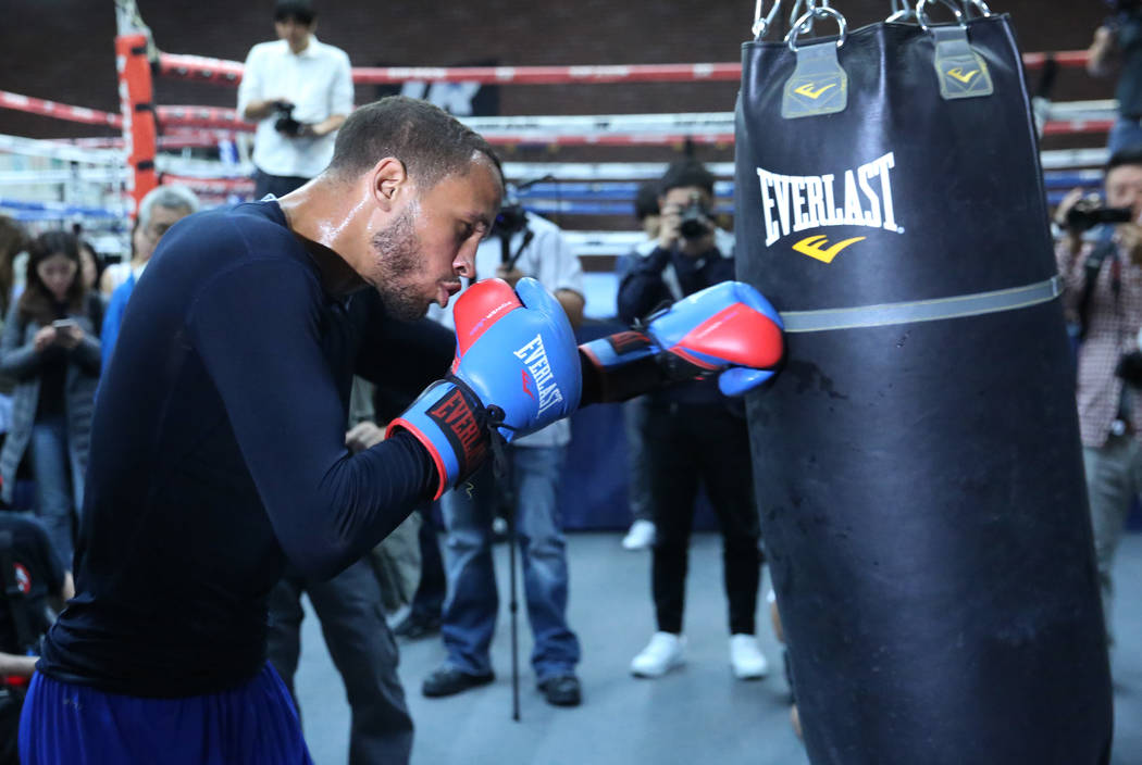 Robert Brant, a middleweight boxer from Oakdale, Minn., hits the bag while training during media day at Top Rank gym on Wednesday, Oct. 17, 2018, in Las Vegas. WBA ÒworldÓ middleweight t ...