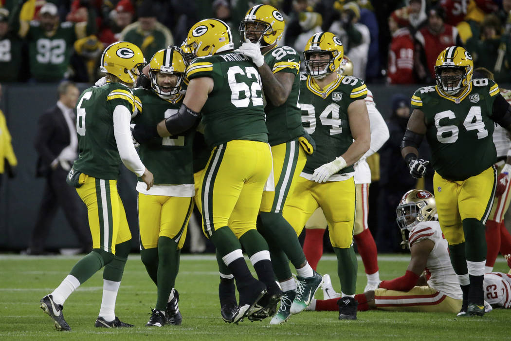 Green Bay Packers kicker Mason Crosby (2) celebrates with his teammates after kicking a game winning field goal during the second half of an NFL football game against the San Francisco 49ers Monda ...