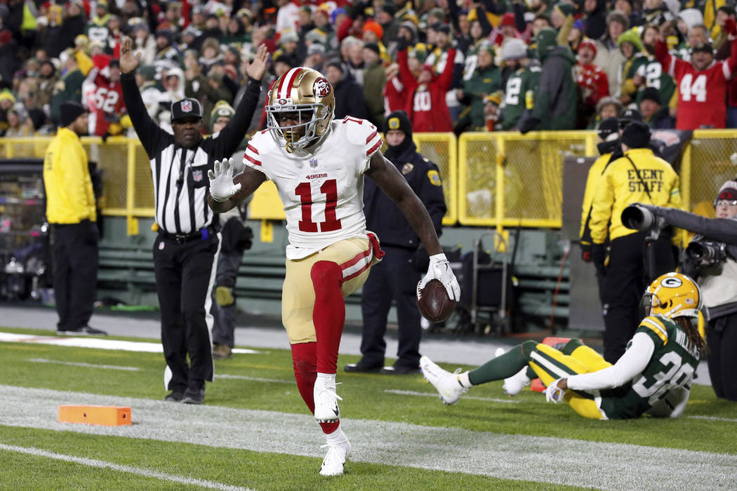 San Francisco 49ers wide receiver Marquise Goodwin (11) celebrates a touchdown during the first half of an NFL football game against the Green Bay Packers Monday, Oct. 15, 2018, in Green Bay, Wis. ...
