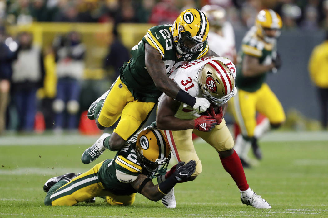 San Francisco 49ers running back Raheem Mostert (31) is tackled by Green Bay Packers free safety Ha Ha Clinton-Dix (21) and strong safety Kentrell Brice (29) during the first half of an NFL footba ...