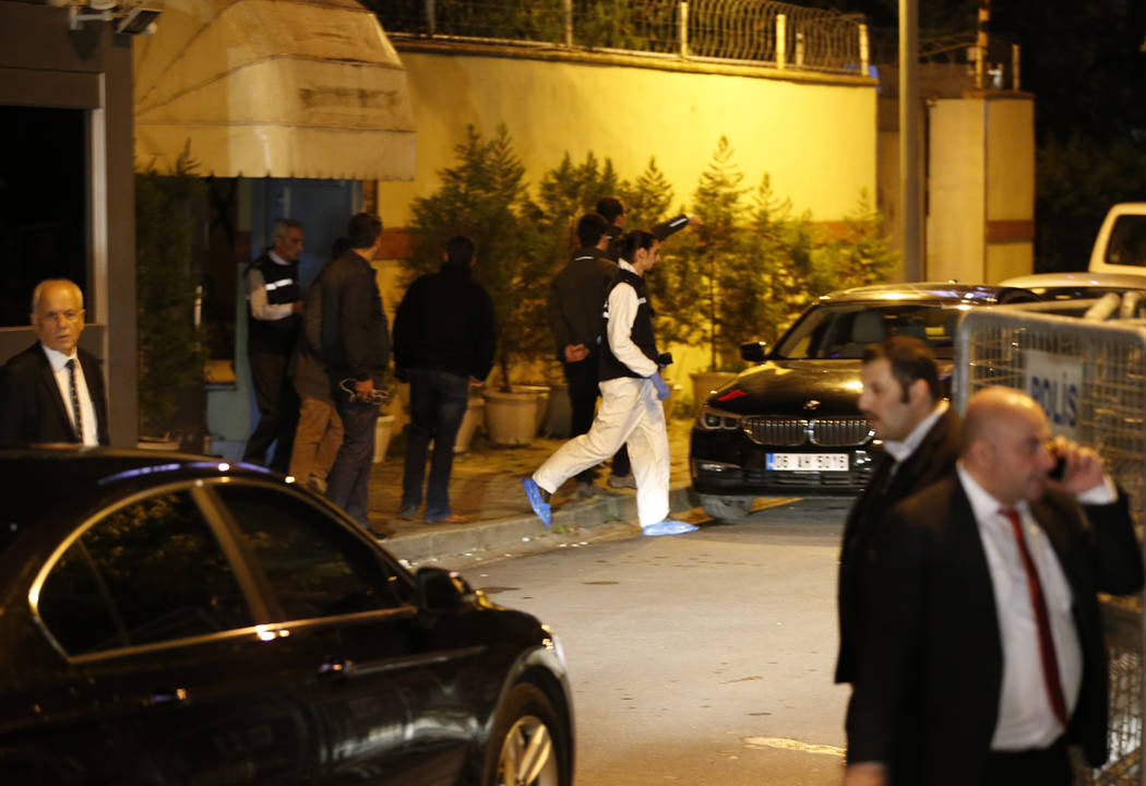 """Turkish police forensic officer exits the Saudi Arabia's Consulate in Istanbul, Monday, Oct. 15, 2018. Turkey and Saudi Arabia are conducting a joint """"inspection"""" on Monday of the consulate, where ..."""