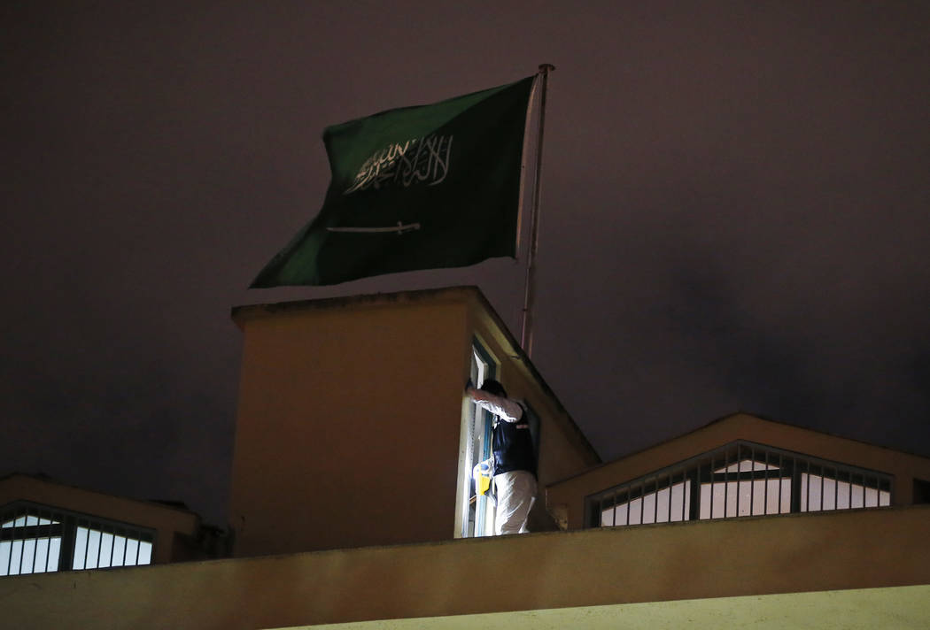 A Turkish forensic police officer searches for evidence as he works on the rooftop of the Saudi Arabia's Consulate in Istanbul, late Monday, Oct. 15, 2018. Turkish crime scene investigators dresse ...