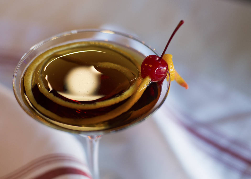 The Pamplona Forever cocktail at Pamplona Tapas restaurant in Las Vegas, Monday, Oct. 15, 2018. The ingredients are Bacardi, Carpano Punt e Mes Vermouth, apple liqueur, Campari, and amaretto cherr ...
