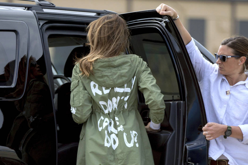 First lady Melania Trump arrives at Andrews Air Force Base, Md., Thursday, June 21, 2018, after visiting the Upbring New Hope Children Center run by the Lutheran Social Services of the South in Mc ...