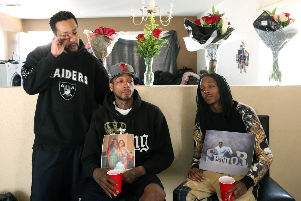 Branden Bell, left, weeps as he speaks with his brothers De'Angelo Nash, center, and De'Andre on Tuesday, Oct. 16 , 2018, about the loss of their three family members who were killed in a parking ...