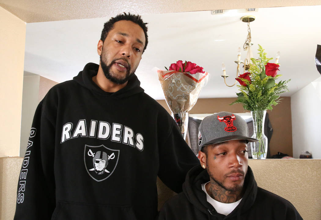 Branden Bell, left, and his brother De'Angelo Nash speak on Tuesday, Oct. 16 , 2018, about the loss of their three family members who were killed in a parking lot at West Lake Mead Boulevard and S ...