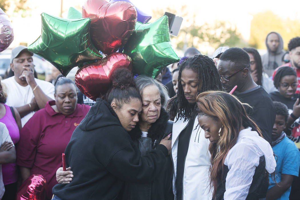 Friends and family come together Monday, Oct. 15, 2018, during a vigil to mourn the loss of three people killed Sunday night, Oct. 14, during a shooting at West Lake Mead Boulevard and Simmons Str ...