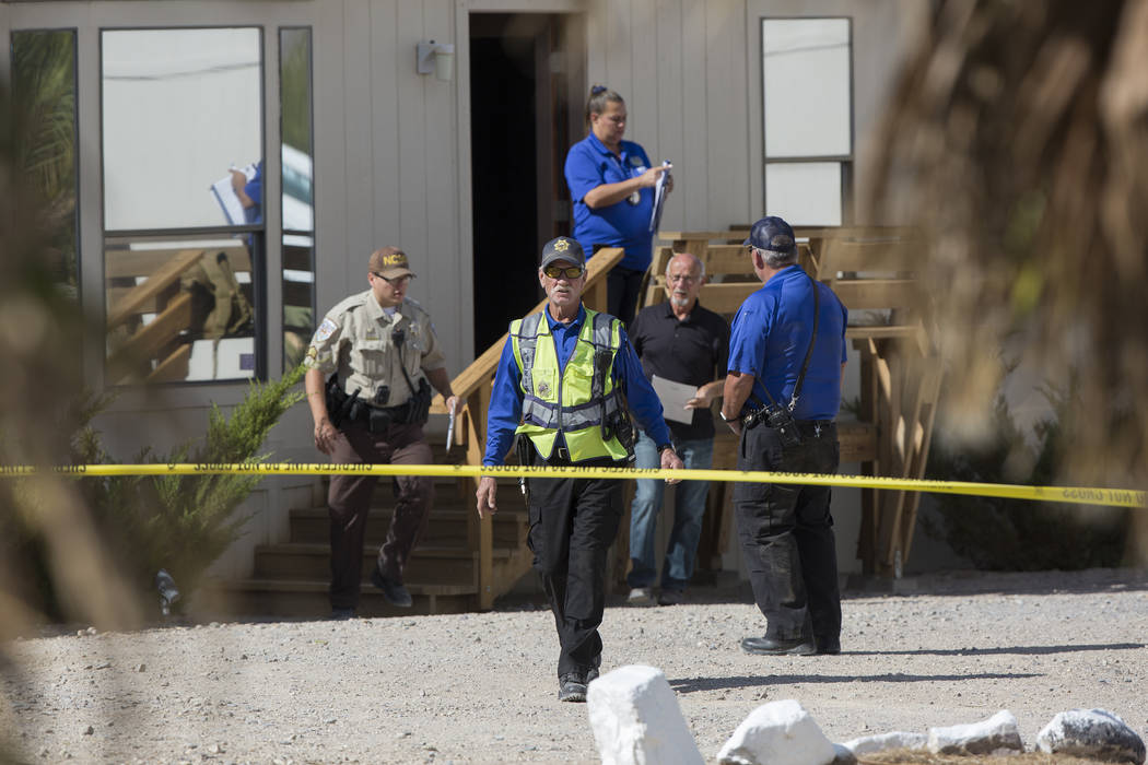 Nye County law enforcement investigate the scene at Dennis Hof's Love Ranch after the prominent brothel owner was found dead this morning at Dennis Hof's Love Ranch on Tuesday, Oct. 16, 2018, in P ...