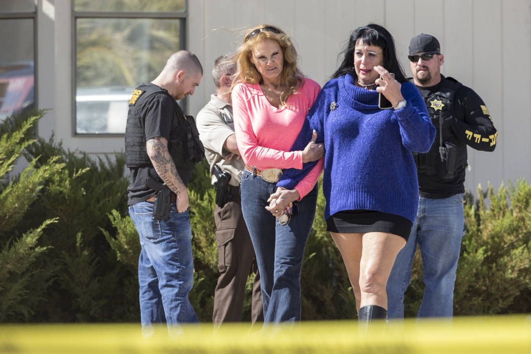 Friends and family walk out of brothel owner Dennis Hof's room, supervised by Nye County law enforcement, after Hof was found dead this morning at Dennis Hof's Love Ranch on Tuesday, Oct. 16, 2018 ...