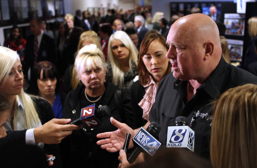 Brothel Dennis Hof answers questions from the media on Tuesday, Feb. 22, 2011 at the Legislature in Carson City, Nev., following a speech from U.S. Senate Majority Leader Harry Reid in which he pr ...