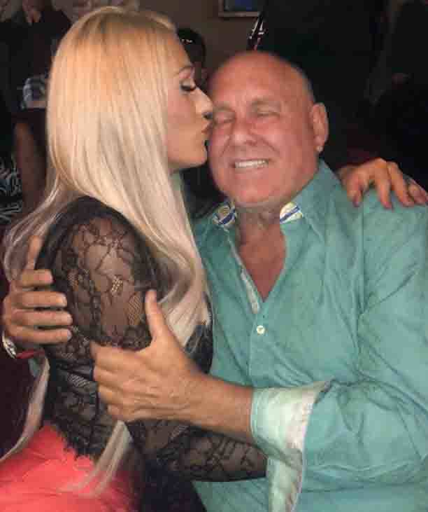 Tiara Tae, who works at Moonlite Bunny Ranch, hugs Dennis Hof during his birthday celebration in this photo posted to her Twitter page on October 15, 2018. (Twitter)