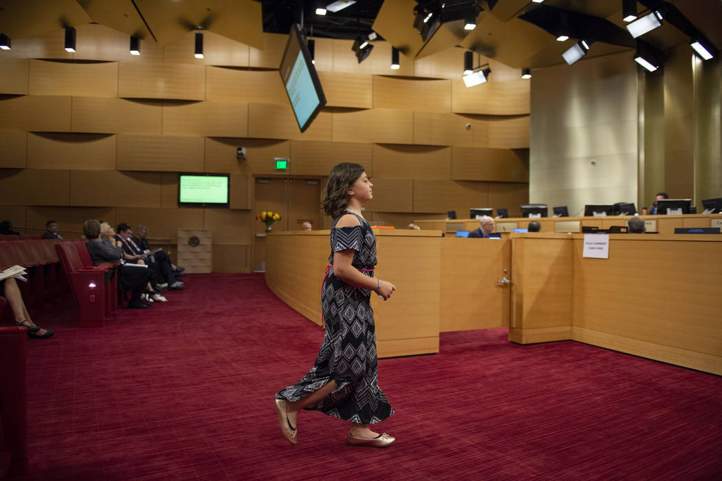Analeia Shields from the Garehime Elementary School fifth grade class walks up to the podium to speak during the class' presentation asking the Las Vegas City Council to name the black-tailed jack ...