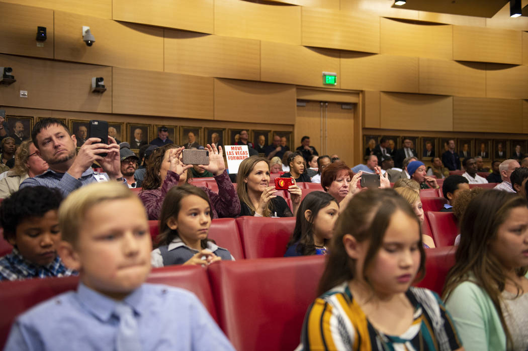 Parents of the Garehime Elementary School fifth grade class take photos as they watch the class deliver a presentation asking City Council to name the black-tailed jackrabbit as the city's officia ...