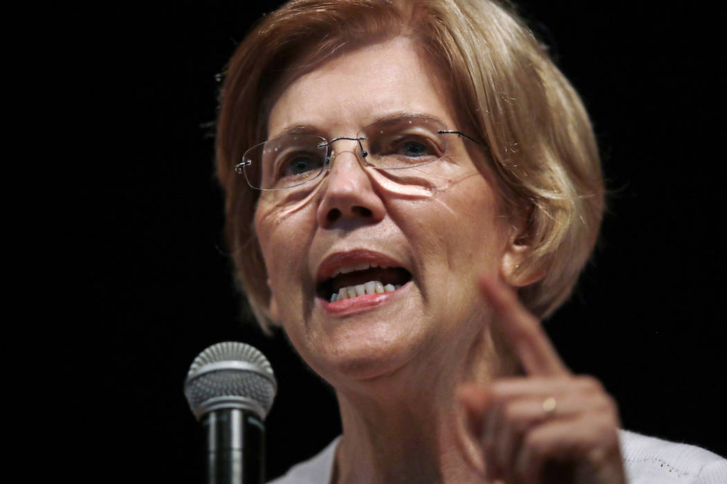 In this Wednesday, Aug. 8, 2018, file photo, U.S. Sen. Elizabeth Warren, D-Mass., speaks during a town hall-style gathering in Woburn, Ma. (AP Photo/Charles Krupa, File)