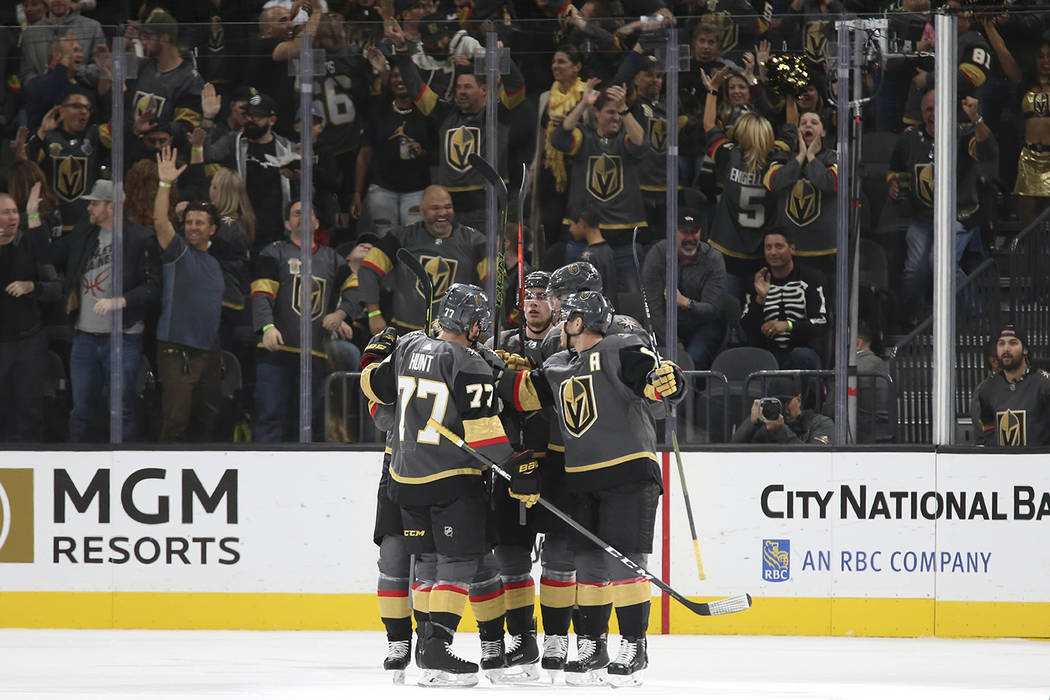 The Vegas Golden Knights celebrate a goal by center Jonathan Marchessault during the first period of an NHL hockey game against the Buffalo Sabres at T-Mobile Arena in Las Vegas, Tuesday, Oct. 16, ...