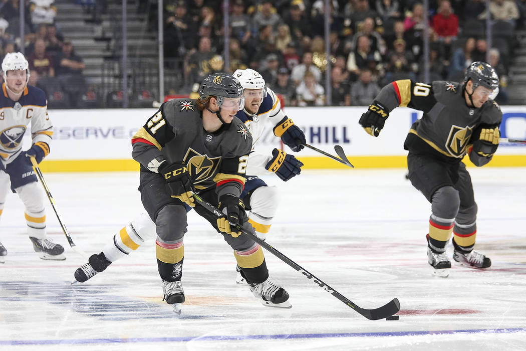 Vegas Golden Knights center Cody Eakin (21) controls the puck before scoring a goal against the Buffalo Sabres during the second period of an NHL hockey game at T-Mobile Arena in Las Vegas, Tuesda ...