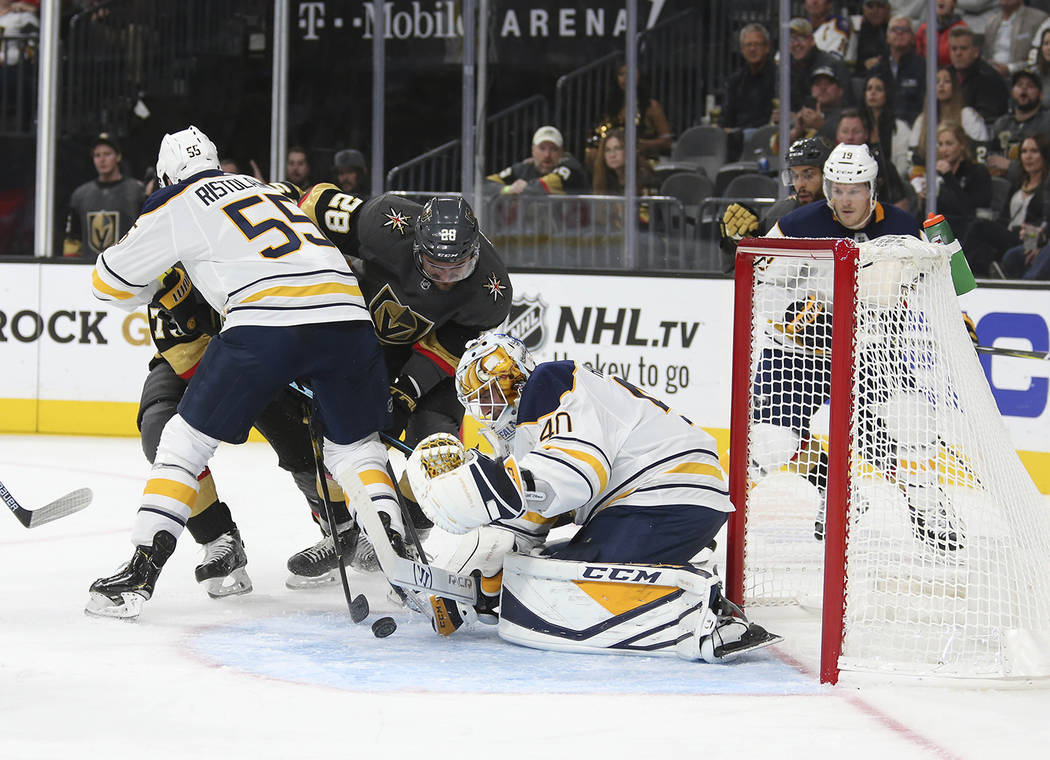 Vegas Golden Knights left wing William Carrier (28) looks for the rebound in front of Buffalo Sabres goaltender Carter Hutton (40) during the second period of an NHL hockey game at T-Mobile Arena ...