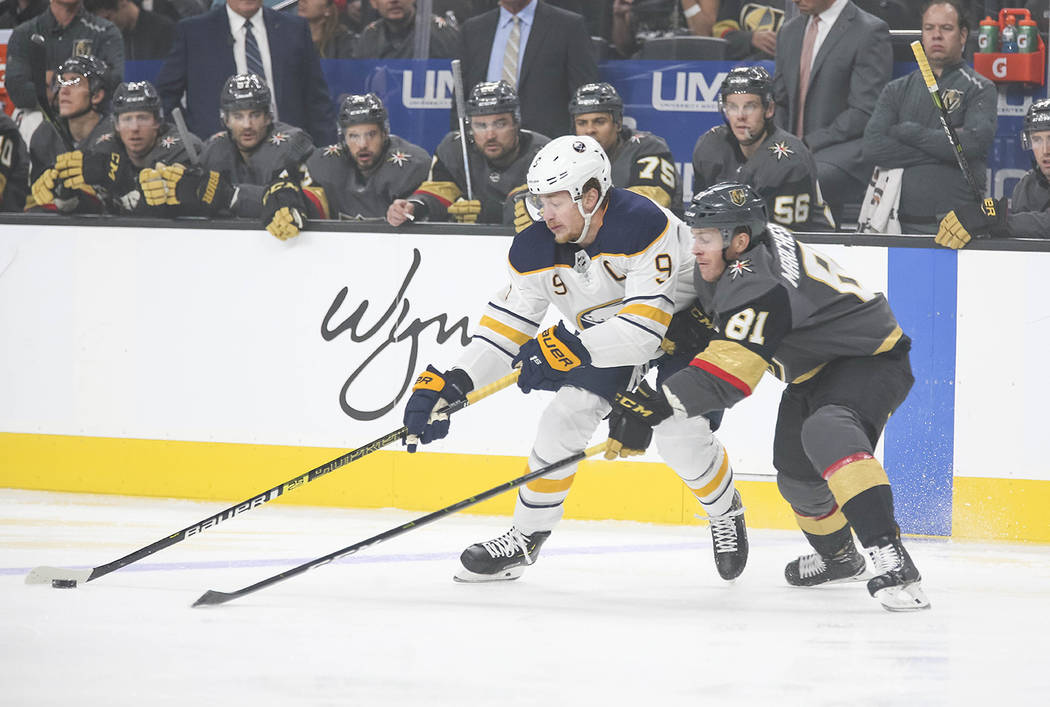 Buffalo Sabres center Jack Eichel (9) and Vegas Golden Knights center Jonathan Marchessault (81) vie for the puck during the first period of an NHL hockey game at T-Mobile Arena in Las Vegas, Tues ...