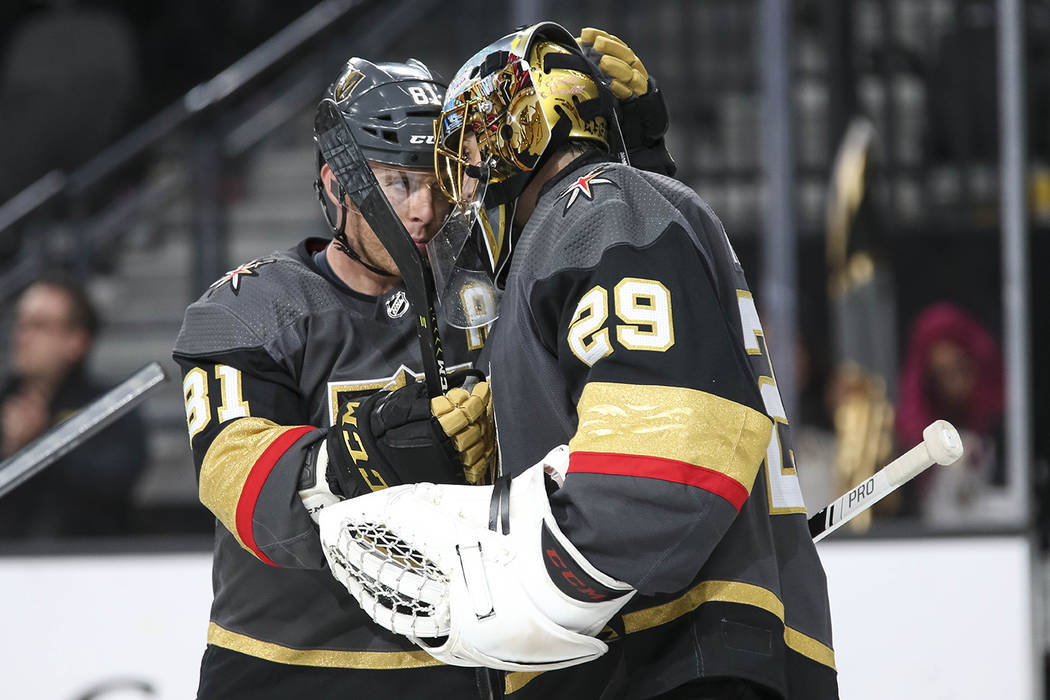 Vegas Golden Knights center Jonathan Marchessault (81) and goaltender Marc-Andre Fleury (29) celebrate their 4-1 victory over the Buffalo Sabres following an NHL hockey game at T-Mobile Arena in L ...