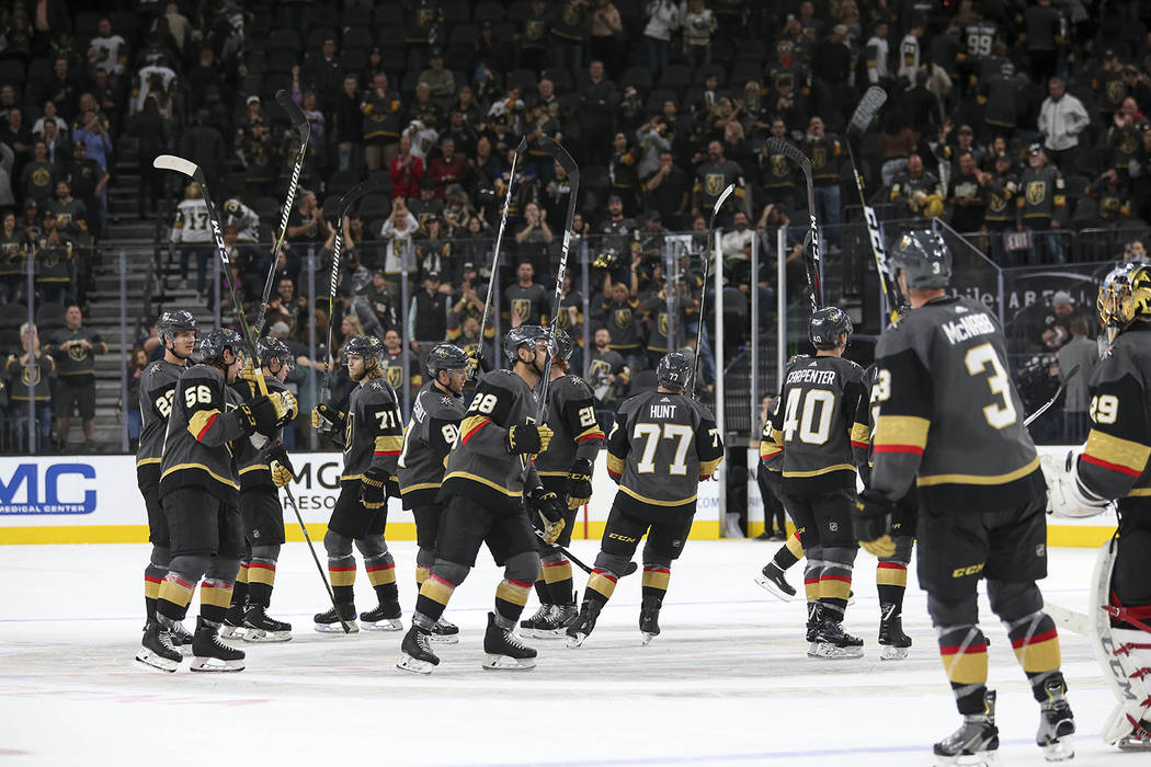The Vegas Golden Knights celebrate their 4-1 victory over the Buffalo Sabres following an NHL hockey game at T-Mobile Arena in Las Vegas, Tuesday, Oct. 16, 2018. Richard Brian Las Vegas Review-Jou ...