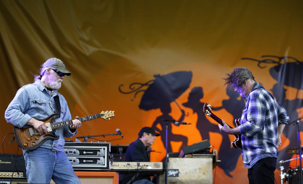 Jimmy Herring, guitarist, left, and John Bell, guitarist and singer for Widespread Panic, perform with the band at the New Orleans Jazz and Heritage Festival in New Orleans, Thursday, May 4, 2017. ...