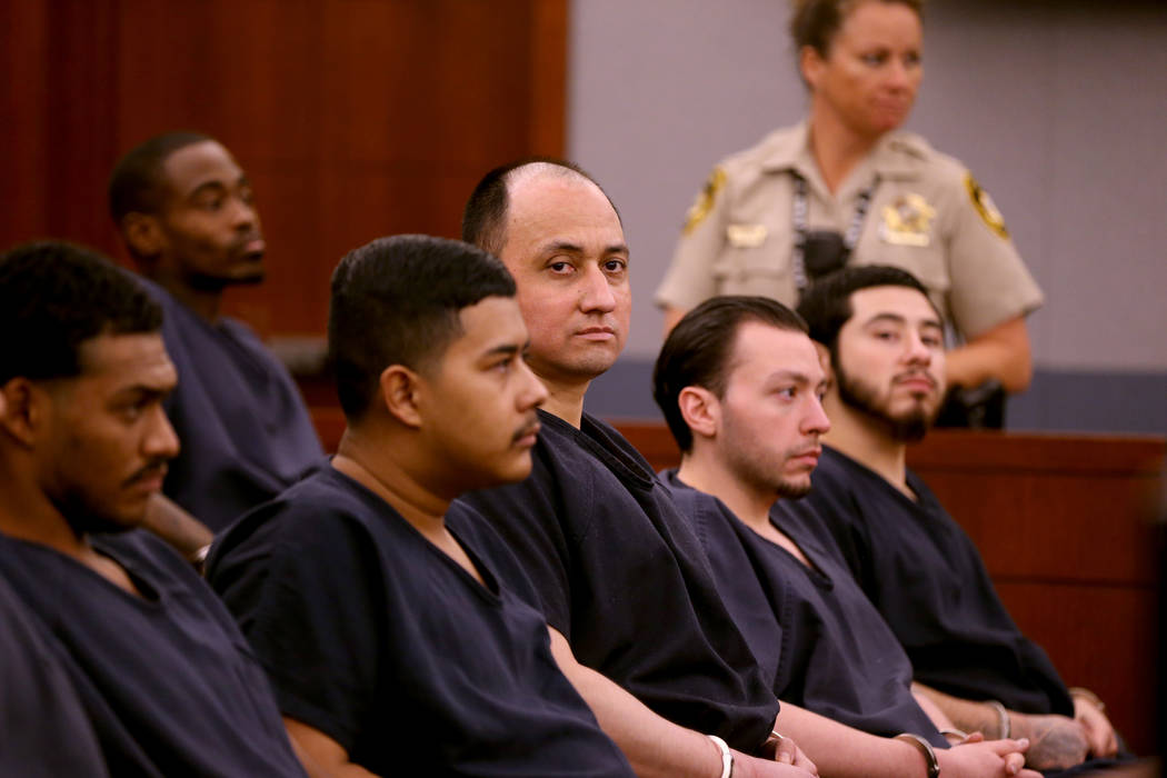 Former Marine Walter Laak, center, waits for sentencing at the Regional Justice Center Tuesday, Oct. 16, 2018. Laak was found guilty but mentally ill of attempted murder with a deadly weapon for a ...