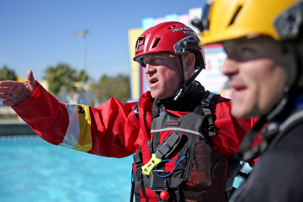 Captain Trenton Beal directs his team of Station 82 firefighters during swift water rescue training at Cowabunga Bay in Henderson, Wednesday, Oct. 17, 2018. The station purchased a new raft that w ...