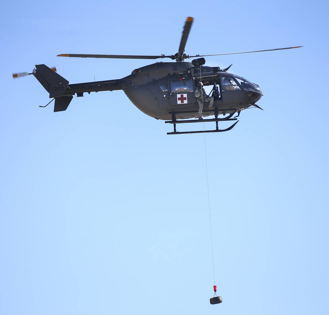 Members of the Nevada Army Guard demonstrate a hoist mission from a UH-72 Lakota helicopter at the support facility by the North Las Vegas Airport in Las Vegas on Friday, Oct. 19, 2018. The six La ...
