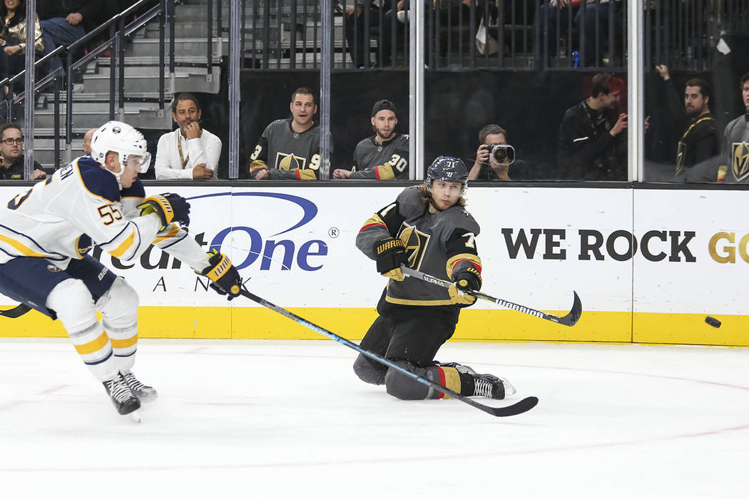 Vegas Golden Knights center William Karlsson (71) takes a shot as he slides on his knees as Buffalo Sabres defenseman Rasmus Ristolainen (55) closes in during the second period of an NHL hockey ga ...