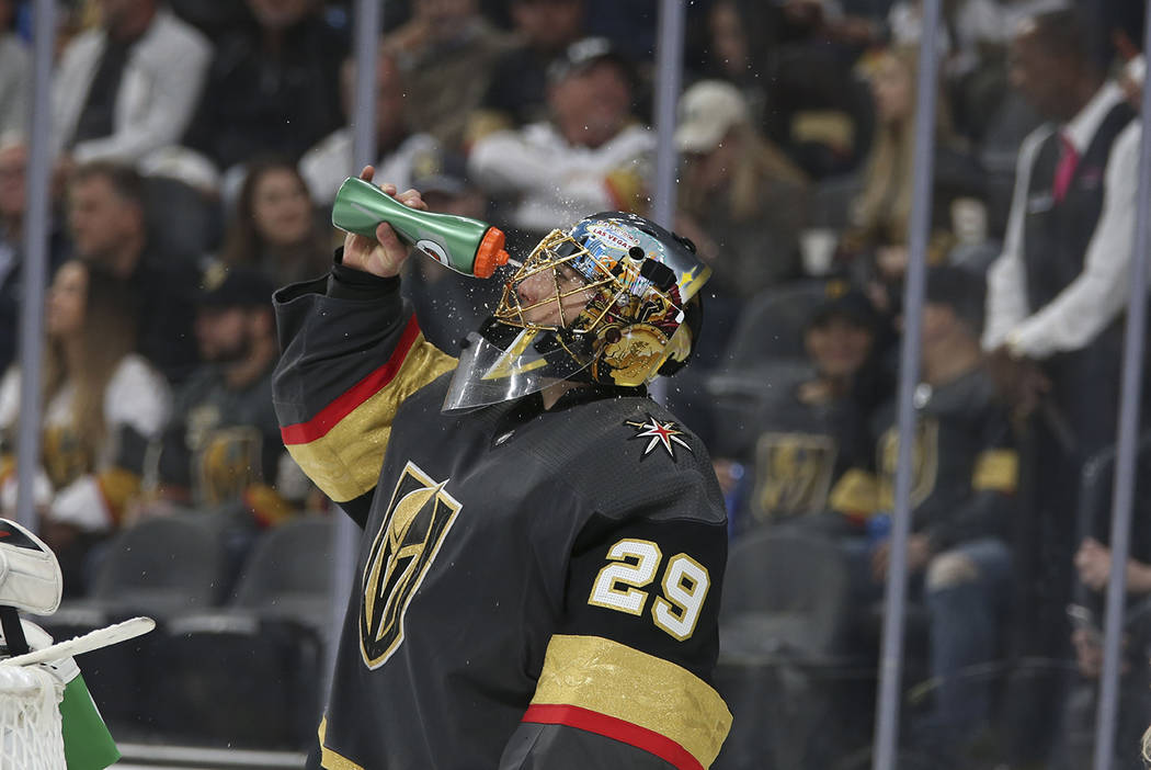 Vegas Golden Knights goaltender Marc-Andre Fleury (29) wets his face on a timeout during third period of an NHL hockey game against the Buffalo Sabres at T-Mobile Arena in Las Vegas, Tuesday, Oct. ...