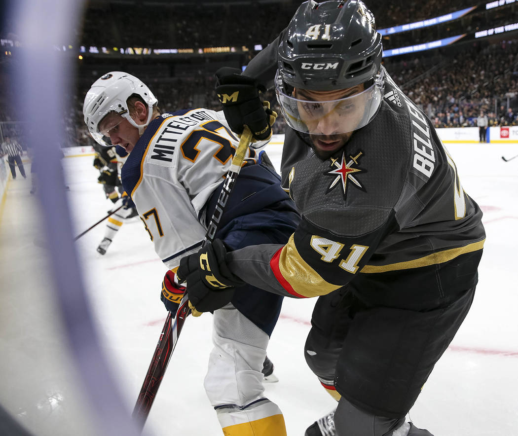 Vegas Golden Knights left wing Pierre-Edouard Bellemare (41) and Buffalo Sabres center Casey Mittelstadt (37) vie for the puck during the third period of an NHL hockey game at T-Mobile Arena in La ...