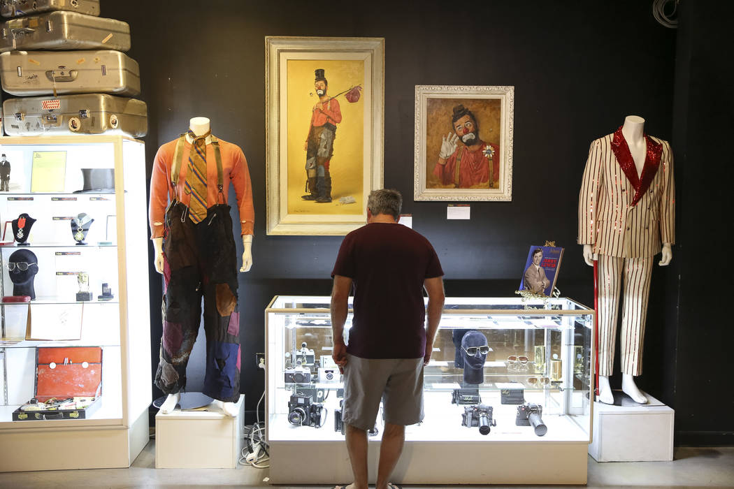 A man browses items belonging to late comedian Jerry Lewis on display during the Julien's Auctions Property from the estate of Jerry Lewis inside Planet Hollywood Resort in Las Vegas on Monday, Ju ...